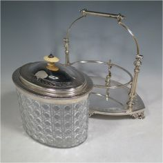 A range of antique silver Biscuit boxes and jars from Bryan Douglas Antique Silver. View silver Biscuit boxes and jars in antique sterling silver and modern sterling silver, and buy online with free, insured delivery. Antique Glass, Antique Silver, Biscuits, Barrels, Jars, Silver Plate, Barware, Container, Victorian