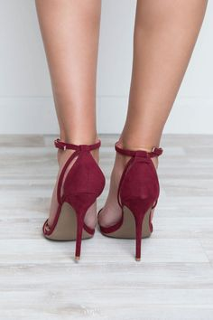 Catch feelings for these burgundy Fernie Heels! Featuring a burgundy faux suede material. Open toe styling. Heel cup with strappy detail. Buckles around the ankle strap for secure closure. Cushioned i