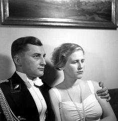 SS-Standartenführer Gunter d'Alquen in a SS tuxedo with his wife in 1944. Gunter d'Alquen was the Chief of the Propaganda Organisation of the Waffen-SS and commander of the Waffen-SS combat war correspondent unit SS-Standarte Kurt Eggers.