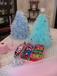 I'm doing this but with black tulle because I have always wanted a black Christmas tree and this way the black color isn't going to be over powering =)