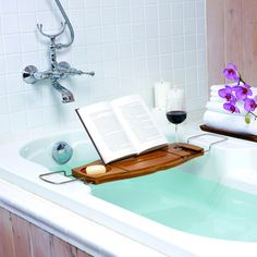 Relax in the bath with confidence, with this Aquala bathtub caddy from Umbra. Made from bamboo, this caddy will not split or mould when used over warm water. With a space for everything, including a book rest and a drink holder, this bathtub caddy is a Bathtub Caddy, Bathtub Tray, Bathtub Shelf, Bathroom Caddy, Bathroom Ideas, Modern Bathroom, Bath Trays, Bathtub Pillow, Wood Bathtub