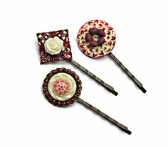 Ruby red and ivory bobby pin trio, Shabby Chic/Victorian/Gypsy Boho inspired, with gorgeous vintage floral buttons, and intricate brass filigree. A beautiful vintage rose, vintage brass flower, and Swarovski crystal chatons embellish these stunning and unusual hair pins. The bobbies are of high quality brass, nickel and lead free. These are one of a kind.