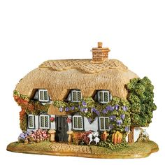 L3710 Woodturner's Cottage- Woodturners Cottage, Hampshire, Middle England. This beautiful five hundered year old New Forest cottage covered with wisteria and honeysuckle is from Ibsley and is home to our woodturner, who has just finished painting his latest wonderful creation ready for his young daughters birthday #handmade #lilliputlane #madeinbritain