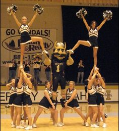 Cheer stunt with mascot!! To bad we don't have a mascot costume like that