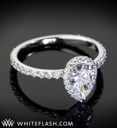 Pear'fect - This Pear Cut Diamond is set in a stunning Halo and its shank is set in a shared prong setting with beautiful ACA Diamonds.