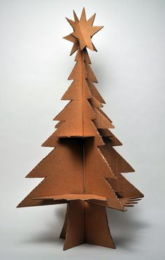 cardboard tree: What a fun idea for the kids Christmas craft project to have in their room! Cardboard Tree, Cardboard Christmas Tree, Cardboard Sculpture, Cardboard Crafts, Diy Christmas Tree, Green Christmas, All Things Christmas, Christmas Holidays, Christmas Decorations