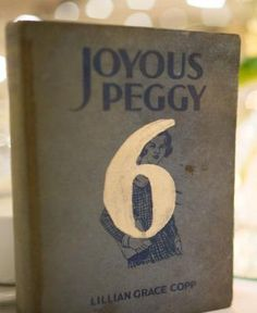 20's vintage (or any era) wedding idea...paint table numbers on old books from the era.