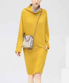 An ode to modernity, this dress features a slouchy contrast-lined cowl neck, front pockets and a relaxed fit. Size note: This item is from a European brand. Please refer to the size chart to ensure best fit. Shipping note: This item is shipping from Australia. Allow extra time for its journey to you.