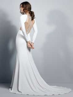 Sottero and Midgley - ARLEIGH, This crepe sheath wedding dress evokes Old Hollywood glamour, featuring long sleeves and an illusion open back accented in beading and Swarovski crystals. Illusion cutouts at the embellished jewel neckline complete this sexy yet elegant gown. Finished with crystal buttons trailing down the train over zipper closure.