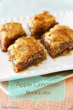 Crispy and nutty Apple Cinnamon Baklava with luscious golden layers of crispy phyllo dough, walnuts, and apples.  A honey syrup made with spiced apple cider deliciously drench each layer. www.yummycrumble.com