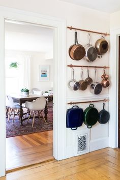 Zan's favorite DIY in the space is the copper pipe pot hangers. He completed them within weeks of moving into the space and they've been essential for storage in the small kitchen.