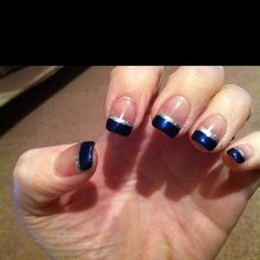 Midnight blue nail polish with silver lining
