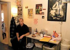 Bill Rathbun sits in his back room, a storage space for memories from happier times. Even leaning slightly on his elbow causes him to wince.
