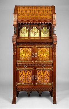 Cabinet, Maker: Attributed to Daniel Pabst (1826–1910) Date: ca. 1877–80 Geography: Mid-Atlantic, Philadelphia, Pennsylvania, United States Culture: American Medium: Walnut, maple, white pine, glass.