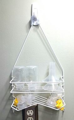Medela pump parts storage. Store pump parts on a shower caddy after washing. Shower caddy from Walmart, attached with 3m Command hook. Medela Pump In Style Advanced. Breastfeeding hacks. Mom hacks. Breastfeeding tips. Pumping tips. Works great for baby bottles too