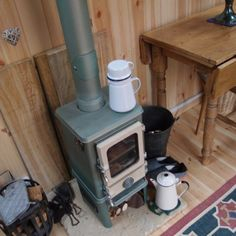 """Woodburning stove """"The Hobbit"""" stove by Salamander stoves. This stove is specifically designed for use in a narrow boat or other small spaces like a She Shed Small Wood Burning Stove, Tiny Wood Stove, Shed Design Plans, Pub Sheds, Craft Shed, Multi Fuel Stove, Small Fireplace, Fireplace Garden, Cast Iron Stove"""