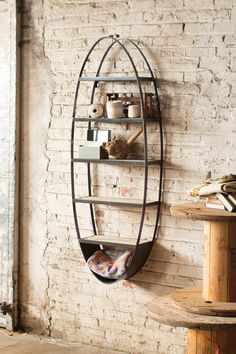 Not sure where we would put this, but really liked it..    wood and metal oval shelf