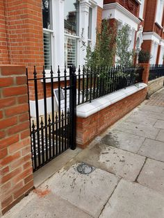 We lovingly restored this wall to be sympathetic to the period property. The addition of cast iron style railings adds a stylish element to this London front garden. Cast Iron, It Cast, Red Brick Walls, Front Gardens, Edwardian House, Red Bricks, Garden Projects, Garden Design, Restoration