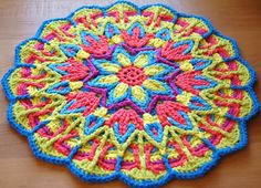 Ever since I saw this mandala design over at A Creative Being I knew I wanted to make one. So I was so excited when I saw her post inviting her followers to an Overlay Mandala Crochet Along because I finally got the excuse I needed to try one out! This gorgeous overlay mandala pattern is by CAROcreated Design and I just LOVE it!!