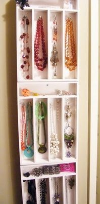 """Hang a Silverware Tray on the wall to neatly organize all of your jewelry...For more organization tips check out the article """"DIY Bathroom Organization Tips"""" by Kitchen Bath Trends"""