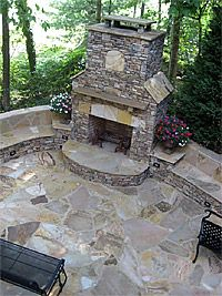 Stone Fireplace with Seating Wall at Night | Fireplaces and Firepits on kitchen countertop seating, kitchen bar seating, kitchen cabinets seating,