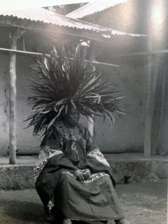 Africa | Wearing a Tyn feather crown (headdress) typically worn by the Bamileke people of Cameroon | These crowns are often referred to in western markets as Juju hats. || Prior to the production for the mass decor / tourist market, feathered crowns were worn exclusively by prominent members of society such as chiefs, diviners and dancers, at weddings, royal affairs and sometimes funerals.