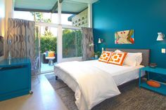 The perfect blue and orange contemporary bedroom retreat.
