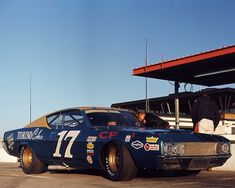 17 Ford, pictured here in 1969 at Daytona International Speedway. David Pearson and the Charlotte-based team combined for 27 wins in the 1968 and 1969 seasons, claiming championships each year. Nascar Race Cars, Old Race Cars, Sprint Cars, Le Mans, Ferrari, Ford Torino, Ford Fairlane, Vintage Race Car, Ford Motor Company