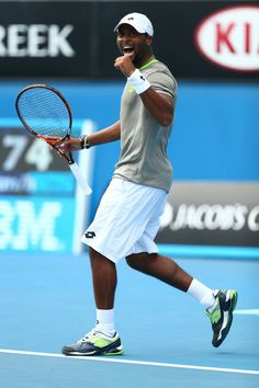 Donald Young of the United States celebrates winning his second round match against Andreas Seppi of Italy during day four of the 2014 Austr...