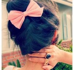 beautiful brown haired up down braid with a pink bow with white polka dots