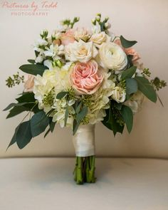 Jennifer's beautiful custom bouquet of white hydrangea, blush garden like roses, white ranunculus, white stock, spray roses and eucalyptus. Wonderful bouquet for spring to compliment blush pink dresses.