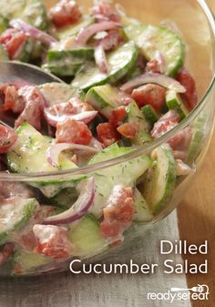 A fresh and delish cucumber salad, lightly tossed in a dill dressing and diced tomatoes.