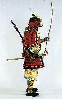 """A """"waidate"""" in the right, """"kyubi no ita"""" (=protector board for the pit of the stomach) and """"sendan"""" are attached to and the breast.  A """"sakaita"""" and an """"agemaki"""" are attached to the back.  To the left arm, """" kote (protector for hand and arm)"""", on the hands, """"yukake"""", to the legs """"habaki (=protector for legs)"""", """"sune-ate"""" (=protector for the shin), """"tsuranuki"""", """"koshi-gatana (=short sword)"""" and a """"Hyogo-gusari"""" long zword is carried at the waist."""