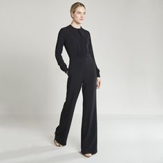 This wide-leg jumpsuit couldn't be any cuter: The big pointed Peter-Pan-collar over center pleats (with elasticized ruching at the front waist for stretch), but