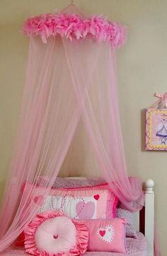 Create a dreamy look that is fit for a princess with this girl's pink bed net canopy that features a fun design that is accented by a faux-feather boa. This easy-to-install 100 percent polyester canopy comes with a hanging hoop and hardware.