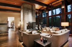 Fascinating-Double-Height-Living-Room-Completed-with-Contemporary-Seating-Units-and-Rectangular-Tables-Featured-with-Recessed-Lighting : Inspirational Interior and Exterior Home Design Ideas – TheMakaroni.com