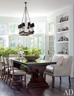 designed by Darryl Carter, a 1940s Italian chandelier . custom-made trestle table. Beaumont & Fletcher settee, English side chairs from Niall Smith Antiques.