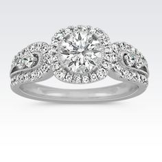 This stunning engagement ring is a breathtaking choice your special someone is sure to adore for a lifetime. Fifty-eight round pav