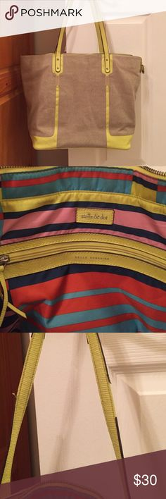 Stella & Dot classic tote 👜 Stella & Dot classic canvas tote with neon yellow detail and straps. Interior is super cute with multi colored lining. Has large interior zip pocket, 2 open pockets (1 for cell phone) and elastic holder for water bottle. Only sign of wear is very minor mark on bottom and brown trim on straps is peeling in spots. Price reflects this. Otherwise, great condition! Stella & Dot Bags