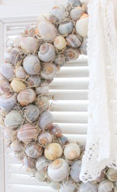 Looks like shells glued to straw wreath, would add embellishments for the season, small pumpkins,small blue glass ornaments, wired or burlap bow,etc