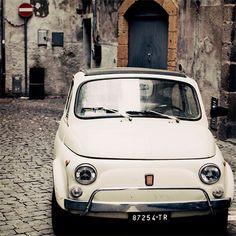 Little cars on tiny cobblestone streets