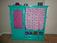dress-up clothes wardrobe made from a repurposed entertainment center. dress up clothes storage dress up clothes organization