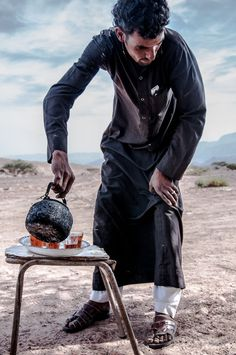 A Man Pouring Tea In The Middle Of Desert, Jordany,