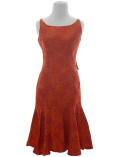 No Label 60's Vintage Dress: 60s -No Label - Sleaveless sheath from an orange red and orange woven brocade. The sheath falls straight down to a five U shaped gore inserts, for a very dancing look. The dress has front princess lines. The back has a 9in metal zipper, with a fabric bow a the top. There is a rounded low front neckline, white back falls to a low U. The top of the sheath is lined in an orange red satin acetate.