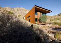 Gracefully embracing the topographic fold of a desert wash, the house focuses on the northeasterly view of the McDowell Mountains in the distance. Arizona