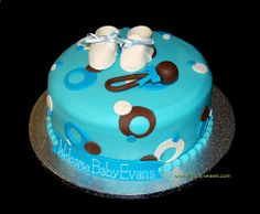I really need to learn how to make cakes w/ fondant!    Baby Evans blue and brown sassy circles baby shower cake by Simply Sweets, via Flickr