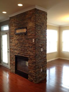 Beautiful double-sided fireplace done in ledger stone.