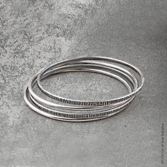 #miglio B1276 Set of four textured and smooth burnished silver bangles