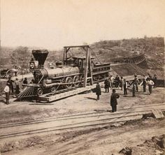 """Locomotive on Turntable """"Building the Central Pacific Railroad: A Photographic Journey,"""" a presentation at the California State Library on Wednesday, Jan. 14, 2015. From 1864 to 1869, Alfred A. Hart, the railroad's official photographer, recorded the progress of the railway's construction from Sacramento, over the Sierra Nevada range, across Nevada to Promontory, Utah, using a 5-by-8 inch wet-plate stereo camera and processing his fragile glass plates in a portable dark tent. A special…"""