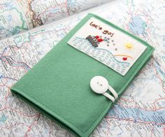 Felt Passport Cover Kids Passport Holder Hand by JennMaruskaDesign - what a neat idea! No more hunting round for your passport with this lovely item.
